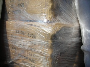 """Sweat"" appears on the inside of a shrink wrapped pallet."