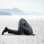 business man with his head in the sand