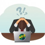 Person frustrated at a laptop with the symbol AES on it