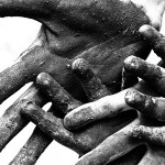 Dirty hands signifying forced labor and child labor