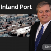 Rich Roche with a picture of a container yard behind him.