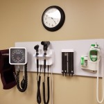 Medical devices hung on a wall in a doctors office.