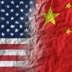 American and Chinese flags merging together.