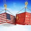 Two containers hitting, one with the American flag painted on it and the other with the Chinese flag painted on it.