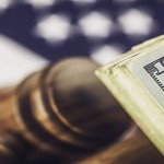 Cash settlement. American currency with gavel. Law, legal, financial, savings.