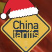 """A Santa hat rests on top of a caution sign with the words """"China tariffs""""."""