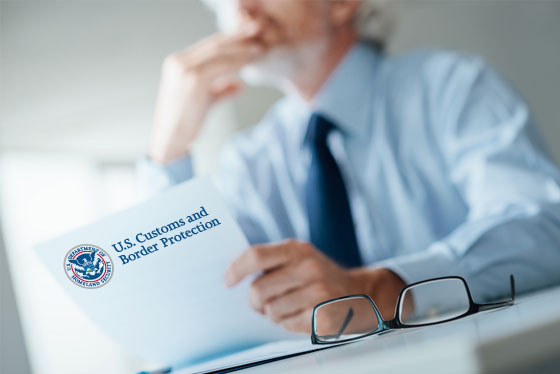 Business man mulls over the contents of an Informed Compliance Publication letter from U.S. Customs