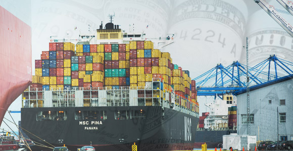 Cargo ship with money faded in background