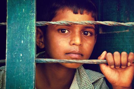 Boy behind bars